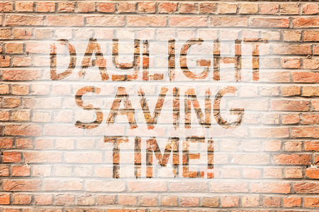 Text sign showing Daylight Saving Time. Business photo text advancing clocks during summer to save electricity Brick Wall art like Graffiti motivational call written on the wall Reklamní fotografie