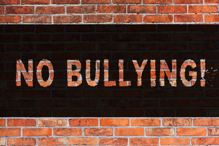 Text sign showing No Bullying. Business photo showcasing Forbidden Abuse Harassment Aggression Assault Brick Wall art like Graffiti motivational call written on the wall