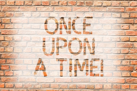 Text sign showing Once Upon A Time. Business photo text telling story Fairytale story Historical event Novel Brick Wall art like Graffiti motivational call written on the wall