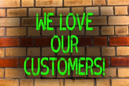 Word writing text We Love Our Customers. Business photo showcasing Client deserves good service satisfaction respect Brick Wall art like Graffiti motivational call written on the wall 写真素材