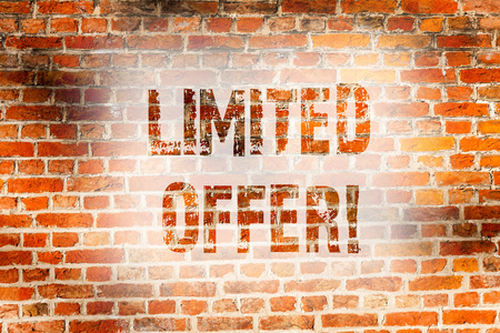 Conceptual hand writing showing Limited Offer. Concept meaning Short time special clearance Price Reduction Brick Wall art like Graffiti motivational written on wall Stock fotó