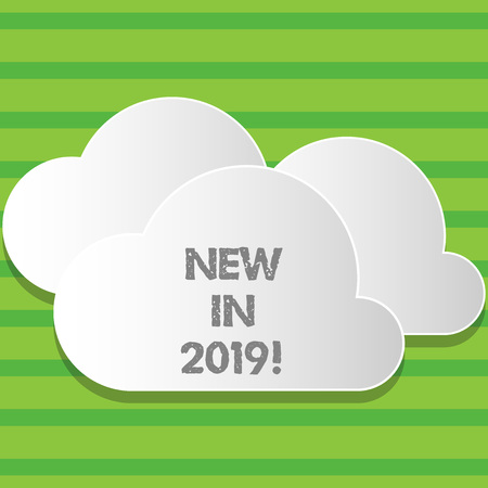 Writing note showing New In 2019. Business concept for upcoming year resolution Advertising new product Specs Stock Photo