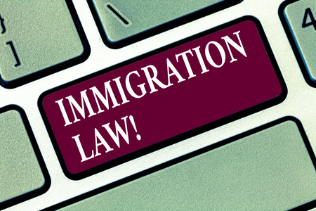 Conceptual hand writing showing Immigration Law. Business photo text National Regulations for immigrants Deportation rules Keyboard key Intention to create computer message idea
