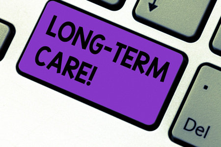 Writing note showing Long Term Care. Business photo showcasing Adult medical nursing Healthcare Elderly Retirement housing Keyboard key Intention to create computer message pressing keypad idea Stock Photo