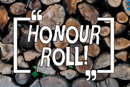 Conceptual hand writing showing Honour Roll. Concept meaning List of students who have earned grades above a specific average Wooden background vintage wood wild message ideas thoughts Stock Photo