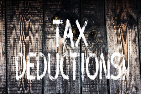 Text sign showing Tax Deductions. Business photo showcasing Reduction on taxes Investment Savings Money Returns Wooden background vintage wood wild message ideas intentions thoughts
