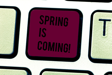 Word writing text Spring Is Coming. Business photo showcasing season after winter in which vegetation begins to appear Keyboard key Intention to create computer message pressing keypad idea