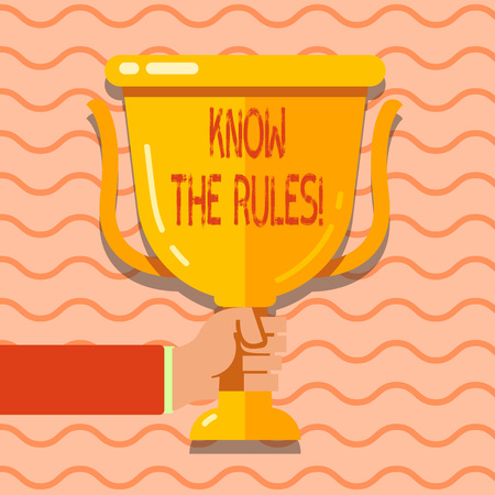 Conceptual hand writing showing Know The Rules. Concept meaning set explicit or regulation principles governing conduct Hand Holding Championship Winners Cup Trophy with Reflection