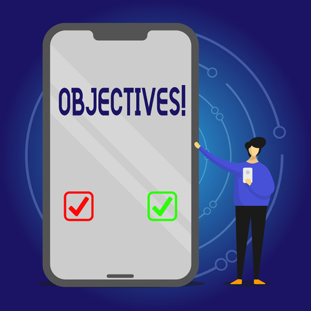 Writing note showing Objectives. Business concept for Goals planned to be achieved Desired targets Company missions Man Presenting Huge Smartphone while Holding Another Mobile Stock fotó