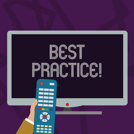 Text sign showing Best Practice. Business photo text commercial procedures that are accepted prescribed being correct Hand Holding Computer Remote Control infront of Blank Wide Color PC Screen