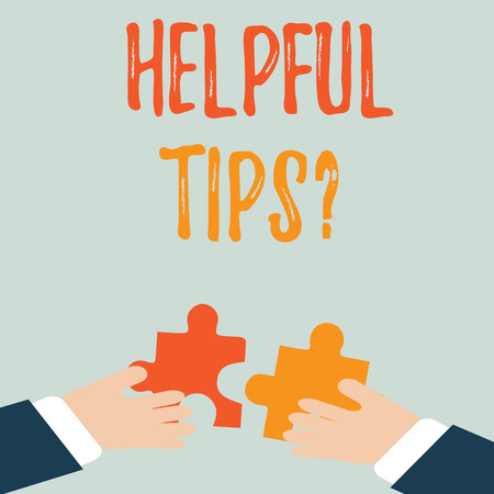 Handwriting text Helpful Tips Question. Conceptual photo secret information or advice given to be helpful knowledge Two Hands Holding Colorful Jigsaw Puzzle Pieces about to Interlock the Tiles