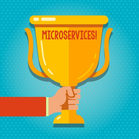 Word writing text Microservices. Business photo showcasing Software development technique Decomposing an application Hand Holding Blank Golden Championship Winners Cup Trophy with Reflection Stock Photo