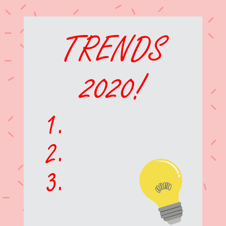 Text sign showing Trends 2020. Business photo showcasing general direction in which something is developing or changing Incandescent Light Bulb with Filament Inside Resting on Blank Color Paper Banco de Imagens