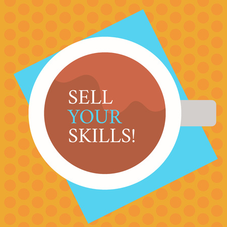 Writing note showing Sell Your Skills. Business concept for make your ability to do something well or expertise shine Top View of Drinking Cup Filled with Beverage on Color Paper photo