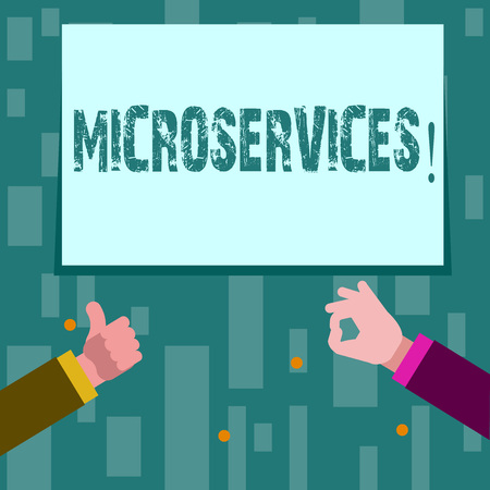 Writing note showing Microservices. Business concept for Software development technique Decomposing an application Two Businessmen Hands Gesturing the Thumbs Up and Okay Sign
