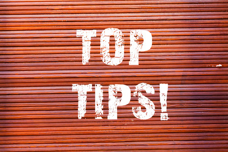 Word writing text Top Tips. Business photo showcasing small but particularly useful piece of practical advice Brick Wall art like Graffiti motivational call written on the wall
