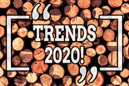 Handwriting text writing Trends 2020. Conceptual photo general direction in which something is developing or changing Wooden background vintage wood wild message ideas intentions thoughts Banco de Imagens