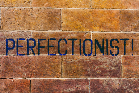 Conceptual hand writing showing Perfectionist. Concept meaning Person who wants everything to be perfect Highest standards Brick Wall art like Graffiti motivational written on wall
