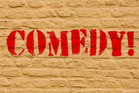 Handwriting text Comedy. Conceptual photo Fun Humor Satire Sitcom Hilarity Joking Entertainment Laughing Brick Wall art like Graffiti motivational call written on the wall