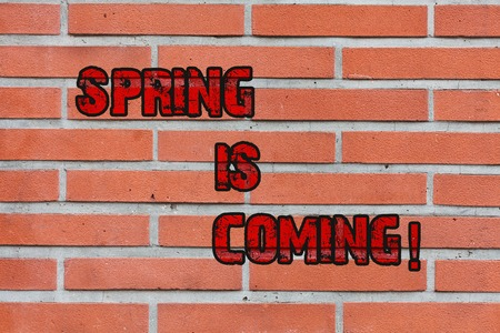 Word writing text Spring Is Coming. Business photo showcasing season after winter in which vegetation begins to appear Brick Wall art like Graffiti motivational call written on the wall Stock Photo
