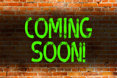 Text sign showing Coming Soon. Business photo showcasing event or action that will happen after really short time Brick Wall art like Graffiti motivational call written on the wall Stock Photo