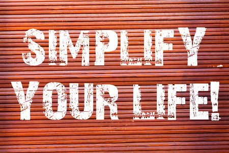 Word writing text Simplify Your Life. Business photo showcasing focused on important and let someone worry about less ones Brick Wall art like Graffiti motivational call written on the wall Foto de archivo - 119213507