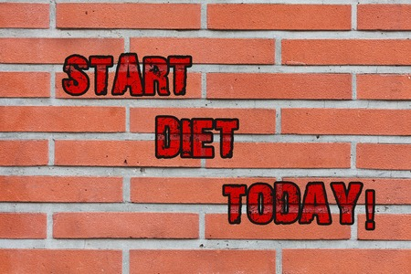 Word writing text Start Diet Today. Business photo showcasing special course food to which demonstrating restricts themselves Brick Wall art like Graffiti motivational call written on the wall Banco de Imagens