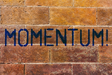 Conceptual hand writing showing Momentum. Concept meaning Quantity motion in moving body Product of mass and velocity Brick Wall art like Graffiti motivational written on wall