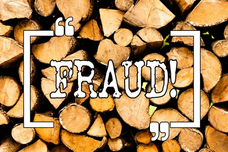 Conceptual hand writing showing Fraud. Concept meaning Criminal deception to get financial or demonstratingal gain Wooden background vintage wood wild message ideas thoughts