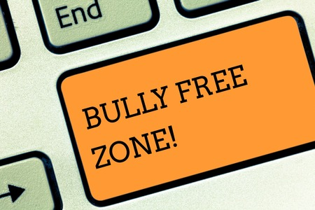 Text sign showing Bully Free Zone. Business photo text creating abuse free school college life Keyboard key Intention to create computer message pressing keypad idea 写真素材
