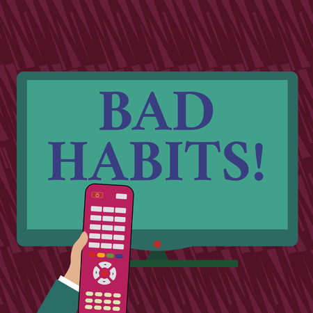 Text sign showing Bad Habits. Business photo showcasing someone do negative behaviour pattern like smoking stereotyping Hand Holding Computer Remote Control infront of Blank Wide Color PC Screen