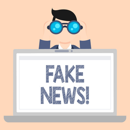 Writing note showing Fake News. Business concept for false stories that appear to spread on internet using other media Man Holding and Looking into Binocular Behind Laptop Screen