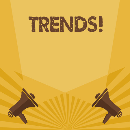 Writing note showing Trends. Business concept for General projected directions of something according to time Spotlight Crisscrossing Upward from Megaphones on the Floor