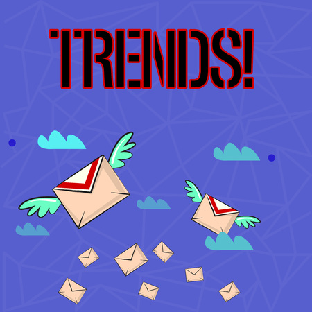 Writing note showing Trends. Business concept for General projected directions of something according to time Colorful Airmail Letter Envelopes and Two of Them with Wings 免版税图像