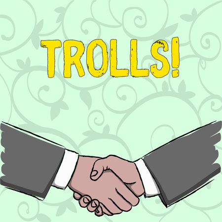 Handwriting text writing Trolls. Conceptual photo Online troublemakers posting provocative inflammatory messages Businessmen Shaking Hands Firmly as Gesture Form of Greeting and Agreement