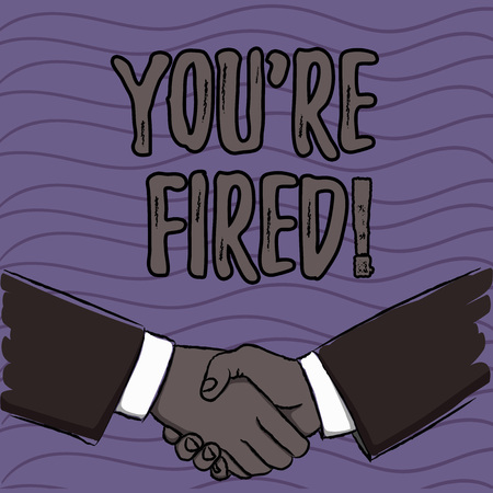 Word writing text You Re Fired. Business photo showcasing Used by boss indicate employee that he is discharged from job Businessmen Shaking Hands Firmly as Gesture Form of Greeting and Agreement