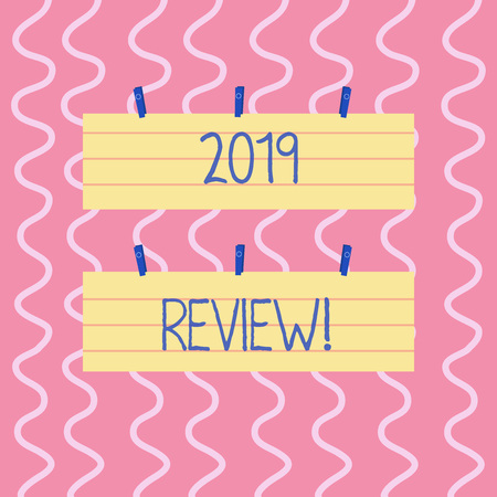 Text sign showing 2019 Review. Business photo showcasing remembering past year events main actions or good shows Two Color Blank Strip Size Lined Paper Sheet Hanging Using Blue Clothespin
