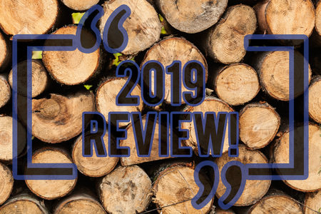 Conceptual hand writing showing 2019 Review. Concept meaning remembering past year events main actions or good shows Wooden background vintage wood wild message ideas thoughts