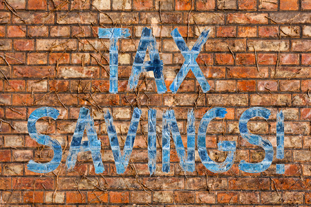 Conceptual hand writing showing Tax Savings. Concept meaning means that you pay reduced amount of taxes than normal Brick Wall art like Graffiti motivational call written on the wall