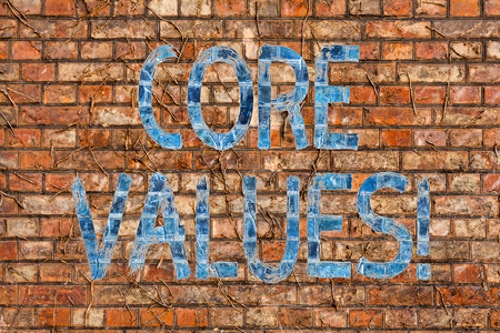 Conceptual hand writing showing Core Values. Concept meaning principle that demonstrating views as being central importance Brick Wall art like Graffiti motivational call written on the wall