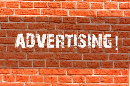 Writing note showing Advertising. Business concept for Reach out world branding with digital marketing optimization Brick Wall art like Graffiti motivational call written on the wall