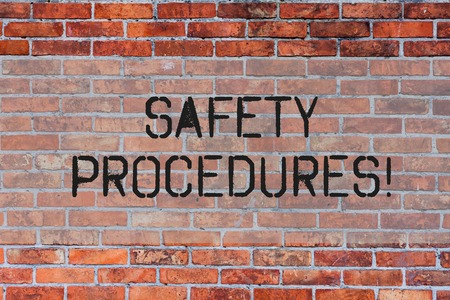 Handwriting text Safety Procedures. Conceptual photo Follow rules and regulations for workplace security Brick Wall art like Graffiti motivational call written on the wall Imagens