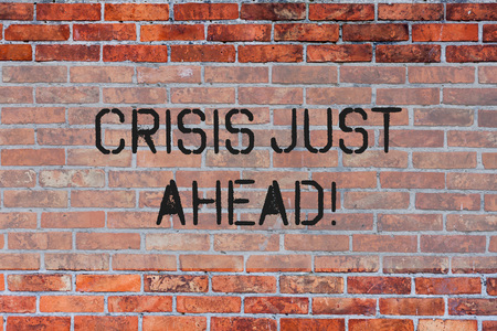 Handwriting text Crisis Just Ahead. Conceptual photo Foresee failure take right action before it is late Brick Wall art like Graffiti motivational call written on the wall