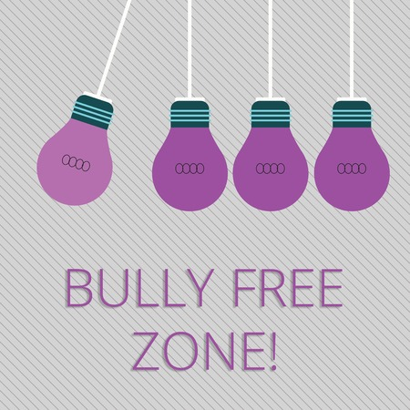Word writing text Bully Free Zone. Business photo showcasing creating abuse free school college life Color Incandescent Pendant Bulb Hanging with One Different Shade Lightbulb 스톡 콘텐츠