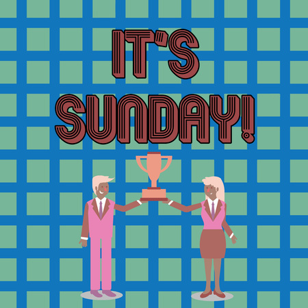 Text sign showing It S Sunday. Business photo text day of week between Saturday and Monday rest in most countries Man and Woman in Business Suit Holding Together the Championship Trophy Cup