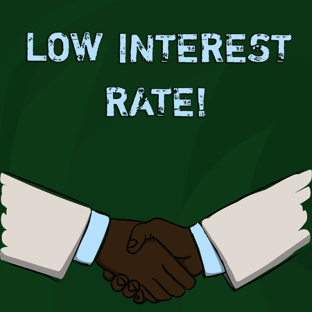 Word writing text Low Interest Rate. Business photo showcasing Manage money wisely pay lesser rates save higher Businessmen Shaking Hands Firmly as Gesture Form of Greeting and Agreement