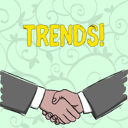 Handwriting text writing Trends. Conceptual photo General projected directions of something according to time Businessmen Shaking Hands Firmly as Gesture Form of Greeting and Agreement