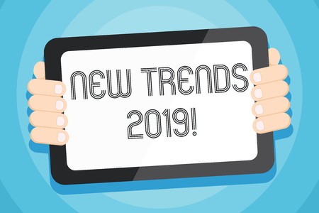 Text sign showing New Trends 2019. Business photo showcasing general direction in which something is developing Color Tablet Smartphone with Blank Screen Handheld from the Back of Gadget 版權商用圖片