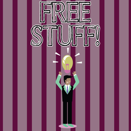 Handwriting text Free Stuff. Conceptual photo giveaways offered by vendors trade shows to encourage attendees Businessman Standing Raising Arms Upward with Lighted Bulb Icon on his Head