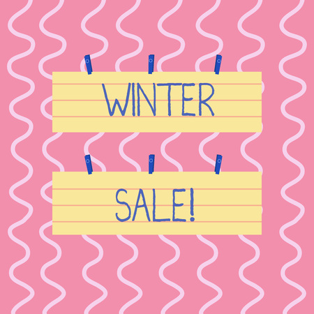 Text sign showing Winter Sale. Business photo showcasing occasion when shop sells things at less than their normal price Two Color Blank Strip Size Lined Paper Sheet Hanging Using Blue Clothespin